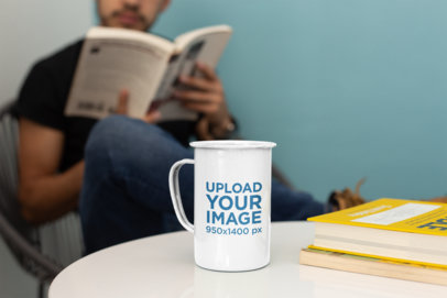 21 Oz Enamel Mockup Featuring a Man Reading in the Back