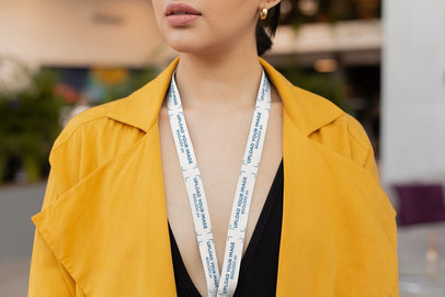 Lanyard Mockup of a Woman in a Yellow Trench Coat