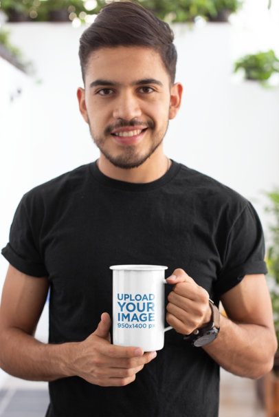 Mockup of a Smiling Bearded Man Holding a 21 Oz Enamel Coffee Mug 26935