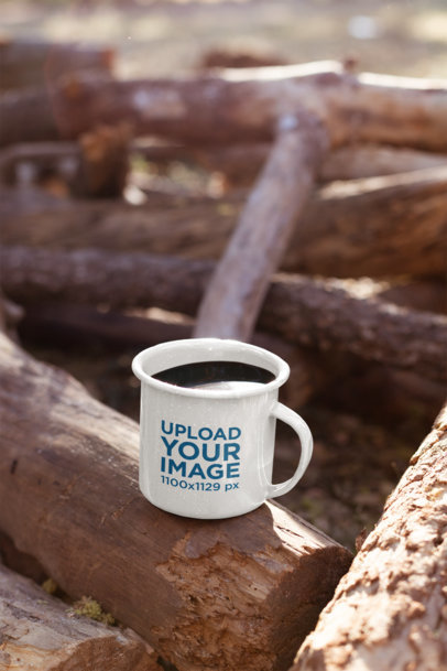 Mockup of a 12 Oz Enamel Mug on a Log at the Woods 26922