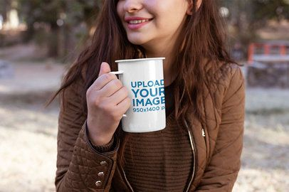 Mockup of a Woman Holding a 21 Oz Enamel Mug at the Outdoors 26923