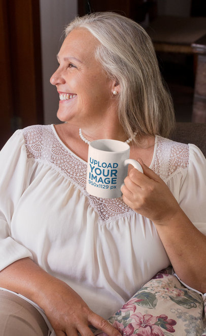 11 Oz Coffee Mug Mockup of a Happy Grandma at Her Living Room 27448