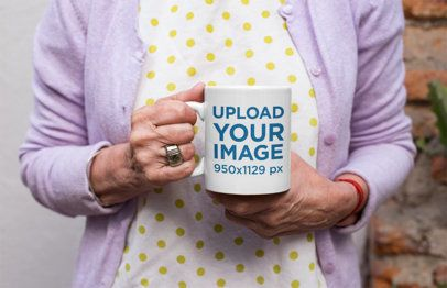 Mockup of an 11oz Coffee Mug in the Hands of a Senior Woman 27443