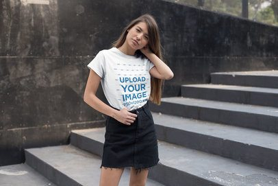 T-Shirt Mockup of a Young Woman Standing by an Urban Stairway 27333
