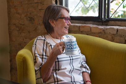 15 Oz Mug Mockup of a Smiling Grandma Sitting on a Couch 27449