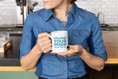 Mockup of a Woman Holding an 11 Oz Coffee Mug in a Kitchen 27234