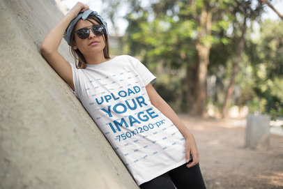 T-Shirt Mockup Featuring a Young Woman with a Headband and Sunglasses 27341