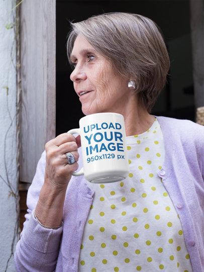 Mockup of a Short Haired Grandma Holding Her 15 Oz Coffee Mug
