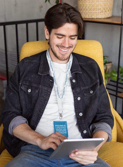 Lanyard Mockup Featuring a Man Checking His Tablet 26535
