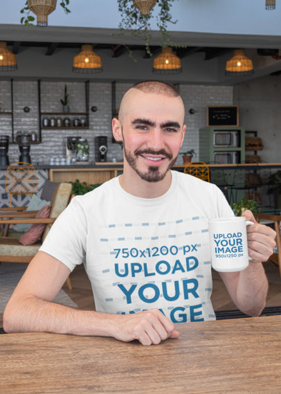 Mockup of a Young Man with a Crewneck T-Shirt Holding a 15 Oz Mug 27520