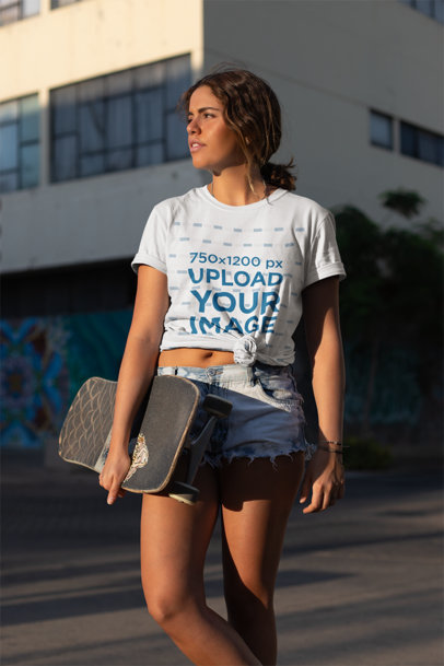 Mockup of a Young Woman with a Skateboard Wearing a Knotted T-Shirt 27076
