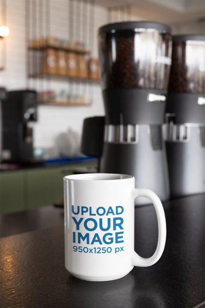 Mockup of a 15 Oz Coffee Mug Against Coffee Grinders at a Cafe 27245