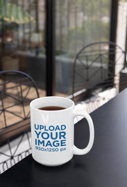 15 Oz Coffee Mug Mockup over a Modern Patio Table 27246