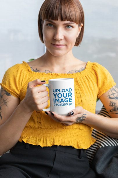 Mockup of a Short-Haired Tattooed Woman Showing a 15 Oz Mug 27248