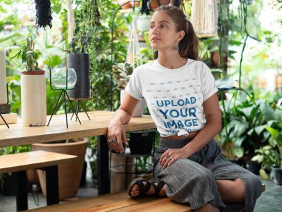 Knotted Tee Mockup Featuring a Relaxed Woman in a Greenhouse 27087