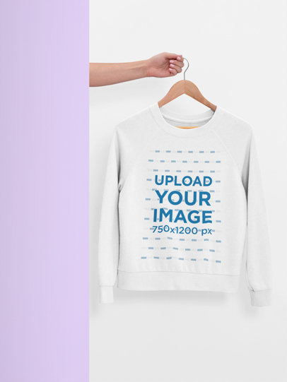 Mockup of a Hanger with a Women's Sweatshirt Mockup Against a Plain Surface 26886