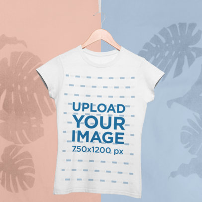 Mockup of a Tee Hanging in Front of a Minimal Colored Background with a Tropical Vibe 27015