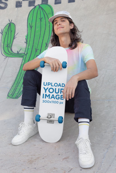 Skateboard Mockup Featuring a Long-Haired Man Sitting on a Ramp 27191