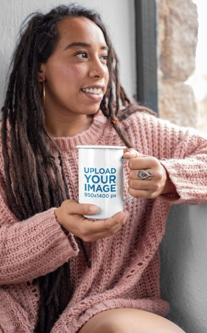 Mockup of a Woman Holding a 21 oz Enamel Mug and Looking through a Window 26976