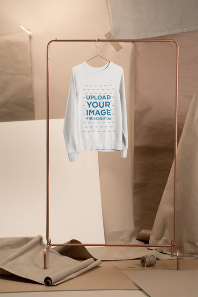 Mockup of a Women's Sweatshirt Hanging at a Craft Stage 27485