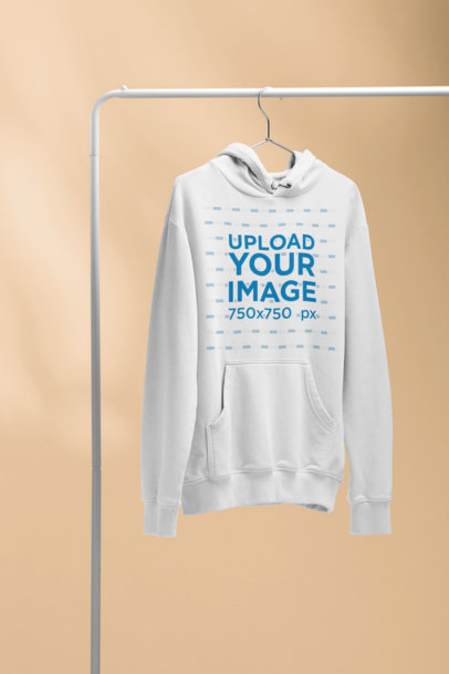 Mockup of a Pullover Hoodie Hanging From a Pipe 27497