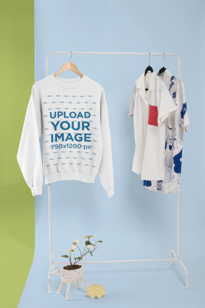 Crewneck Sweatshirt Mockup Hanged in a Rack with Other Shirts 26739