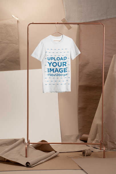 Crewneck T-Shirt Mockup Hanged on a Simple Cooper Rack 27486