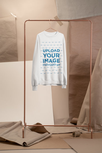 Mockup of a Crewneck Sweatshirt Hanging at a Craft Stage 27487