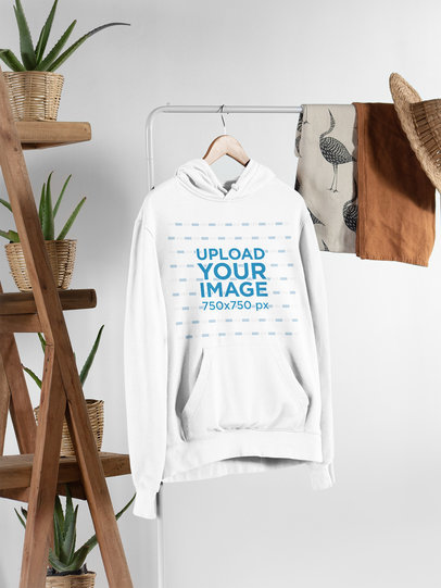 Mockup of a Hanged Men's Pullover Hoodie Featuring a Setting with a Rustic Vibe 27383