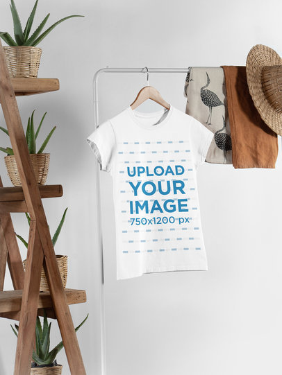 Mockup of a Women's T-Shirt Hanged Next to Some Plant Pots and Other Garments 27395