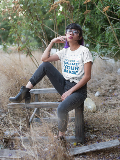 Knotted T-Shirt Mockup Featuring an Edgy Woman Surrounded by Dry Grass 27069