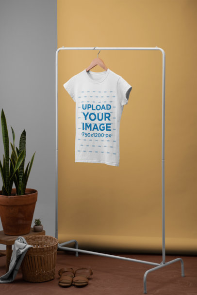 Women's T-Shirt Mockup Hanged from a Rack Next to a Plant Pot and a Basket 27489