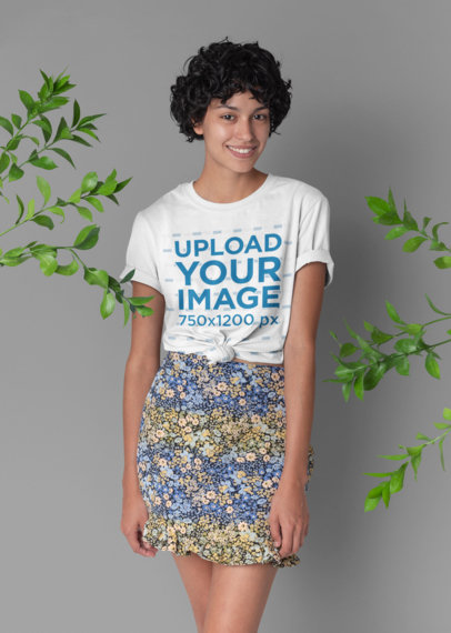 Knotted Tee Mockup Featuring a Woman with Short Hair Surrounded by Some Plants 27291