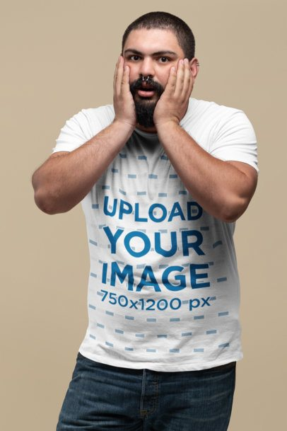 Plus Size T-Shirt Mockup Featuring a Man Holding His Face with Surprise 27757