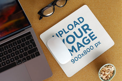Mockup of a Mousepad Lying on a Work Desk 27566
