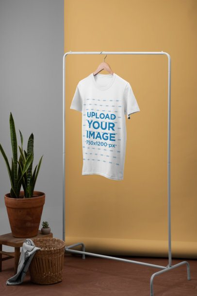 T-Shirt Mockup Featuring a Minimalistic Setting with Plants 27492