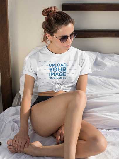 Mockup of a Woman Wearing a Knotted T-Shirt at a Beach Hotel Room 27305