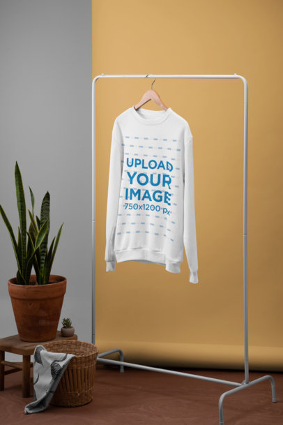 Minimal Crewneck Sweatshirt Mockup Hanging Next to a Plant Pot and a Basket 27493