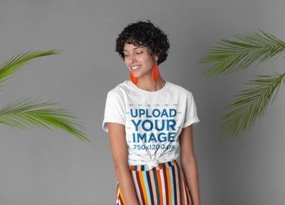 Knotted Tee Mockup Featuring a Woman Surrounded by Palm Leaves 27290