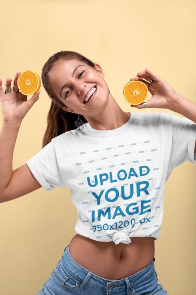 Knotted T-Shirt Mockup of a Smiling Woman Holding Two Halves of an Orange 27093