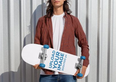 Mockup of a Rebel Man Holding a Skateboard 27201