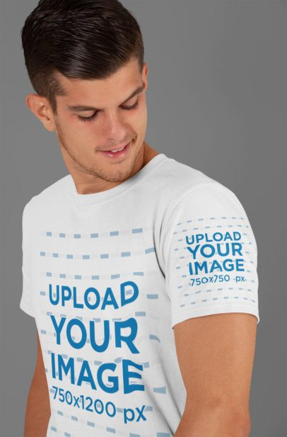 Mockup of a Man Looking at His T-Shirt Sleeve 27131