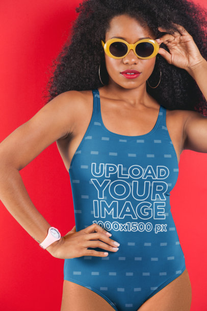 Swimsuit Mockup Featuring a Woman with Sunglasses Posing in Front of a Solid Color Backdrop 26568