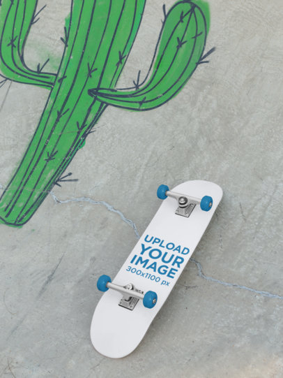 Mockup of a Skateboard Lying on a Graffitied Ramp 27204