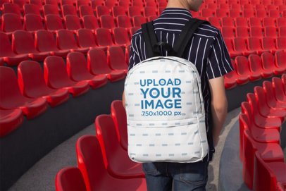 Backpack Mockup of a Kid by Stadium Seats Facing Backward 27695
