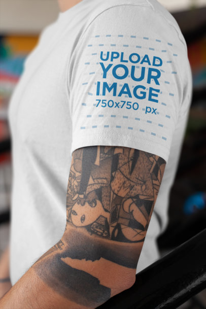 T-Shirt Sleeve Mockup Featuring a Man's Tattooed Arm 27141