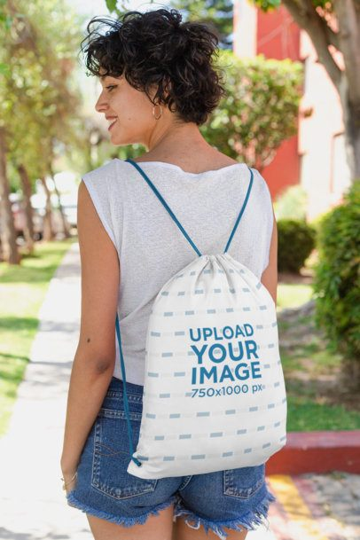 Mockup of a Short-Haired Woman with a Drawstring Bag on Her Back 27570
