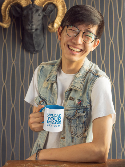 Mockup of a Joyful Man with Glasses Holding a Two-Toned 11 oz Mug 27819