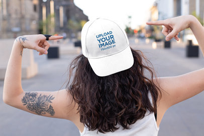 21a09c5a0 Mockup of a Tattooed Woman in the Street Pointing at Her Dad Hat 27038