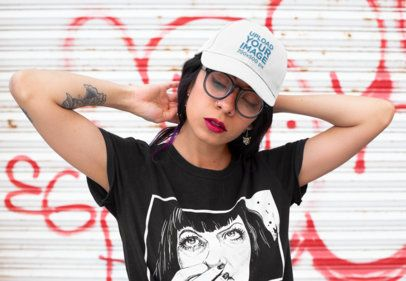 Dad Hat Mockup Featuring a Woman Posing Against a Graffiti Wall 27101